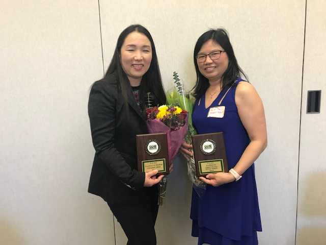 Lillian Choi and Nelly Thein pose with their awards from California Council of Adult Education.